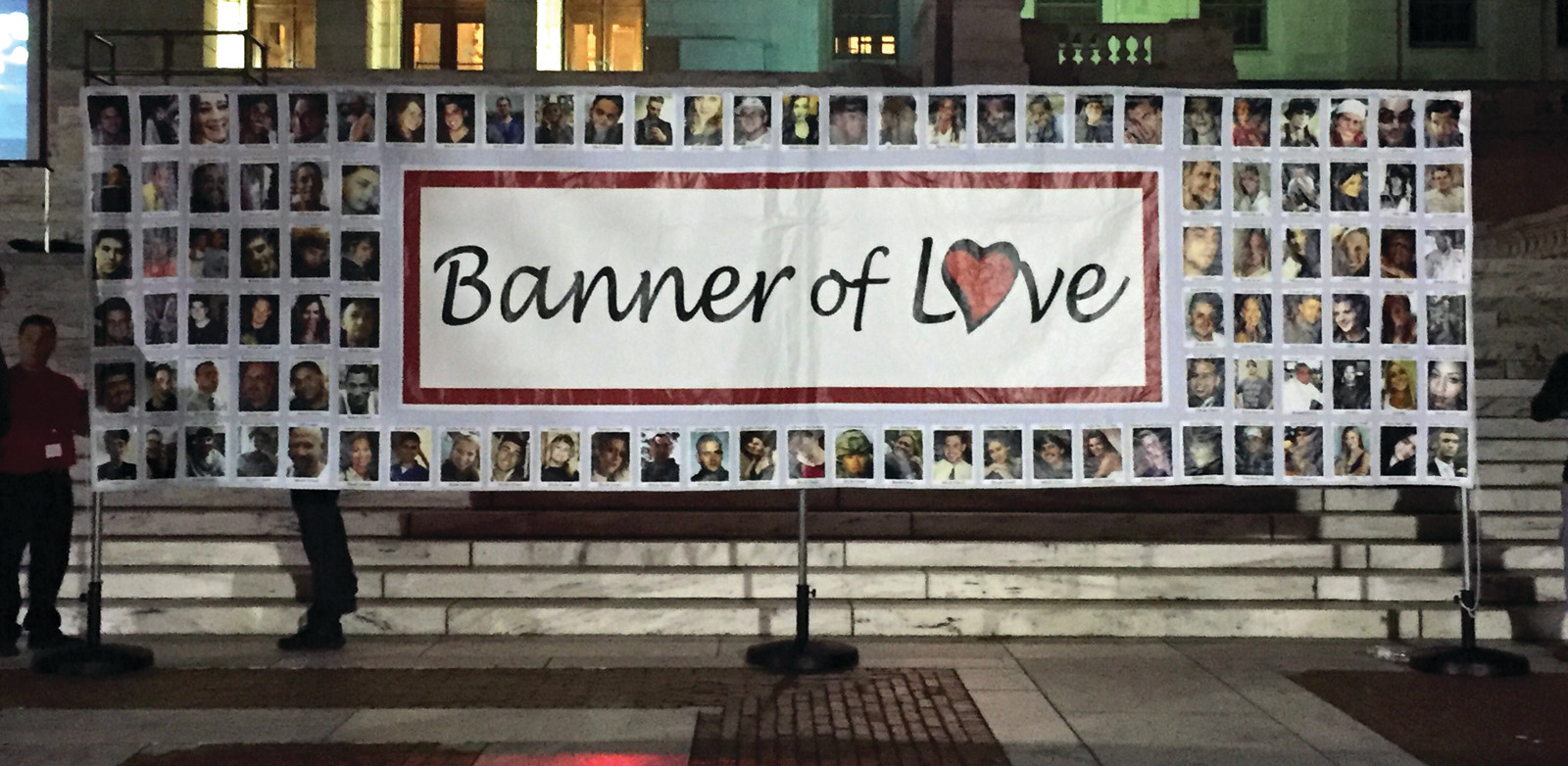 LOVE FROM AROUND THE STATE: The Banner of Love was raised on the steps of the State House last Thursday night, depicting those lost to overdose. (Sun Rise photos by Zack DeLuca)