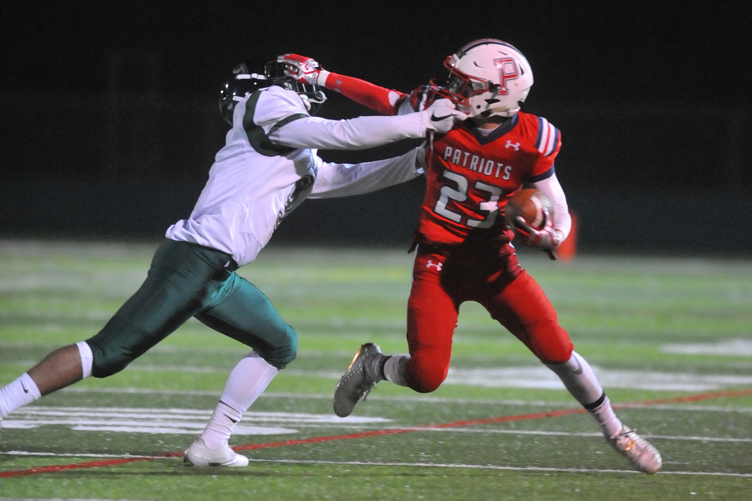 Portsmouth's Daniel Correia stiff-arms a Cranston East defender during the fourth quarter Saturday.