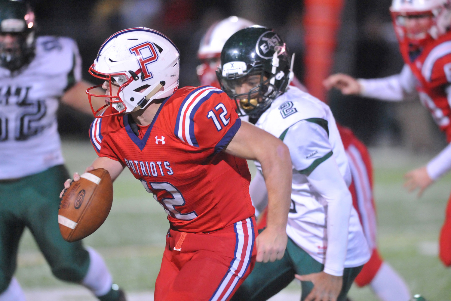 Portsmouth quarterback Kyle Bicho tries to evade the Cranston East pass rush late in the fourth quarter Saturday night.