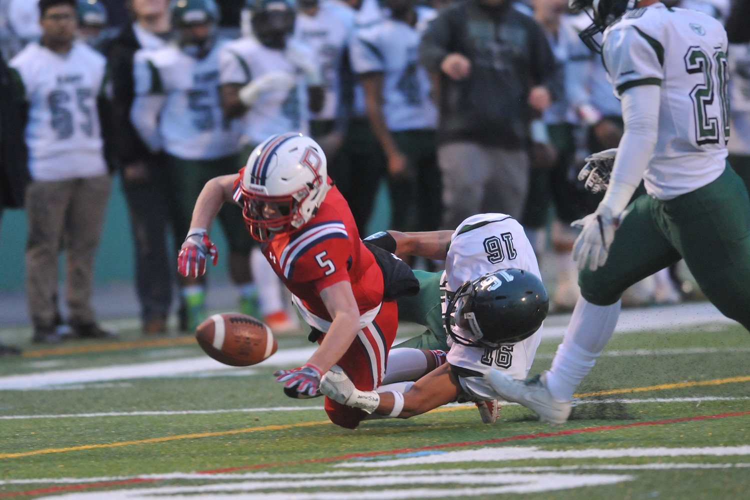 Portsmouth wide receiver Brian Hamilton fumbles the ball on the Patriots' first drive of the game in Saturday's Division I championship game.
