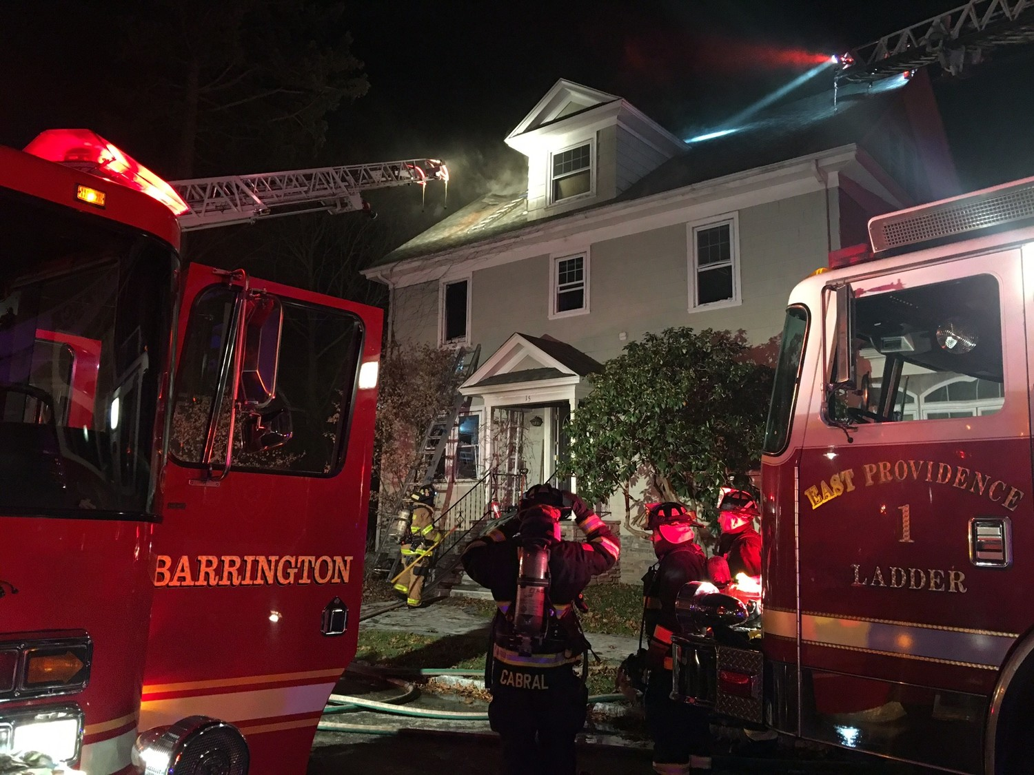 Firefighters work to extinguish a fire that broke out in a Bowden Avenue home in Barrington Wednesday night.