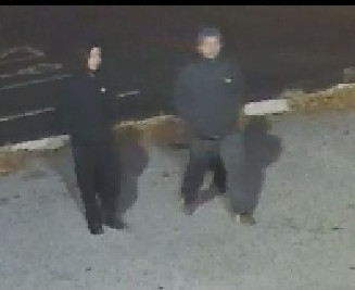 Two male suspects in the theft-stabbing at Town Wine & Spirits as captured by security cameras at the business Saturday evening, Dec. 2.