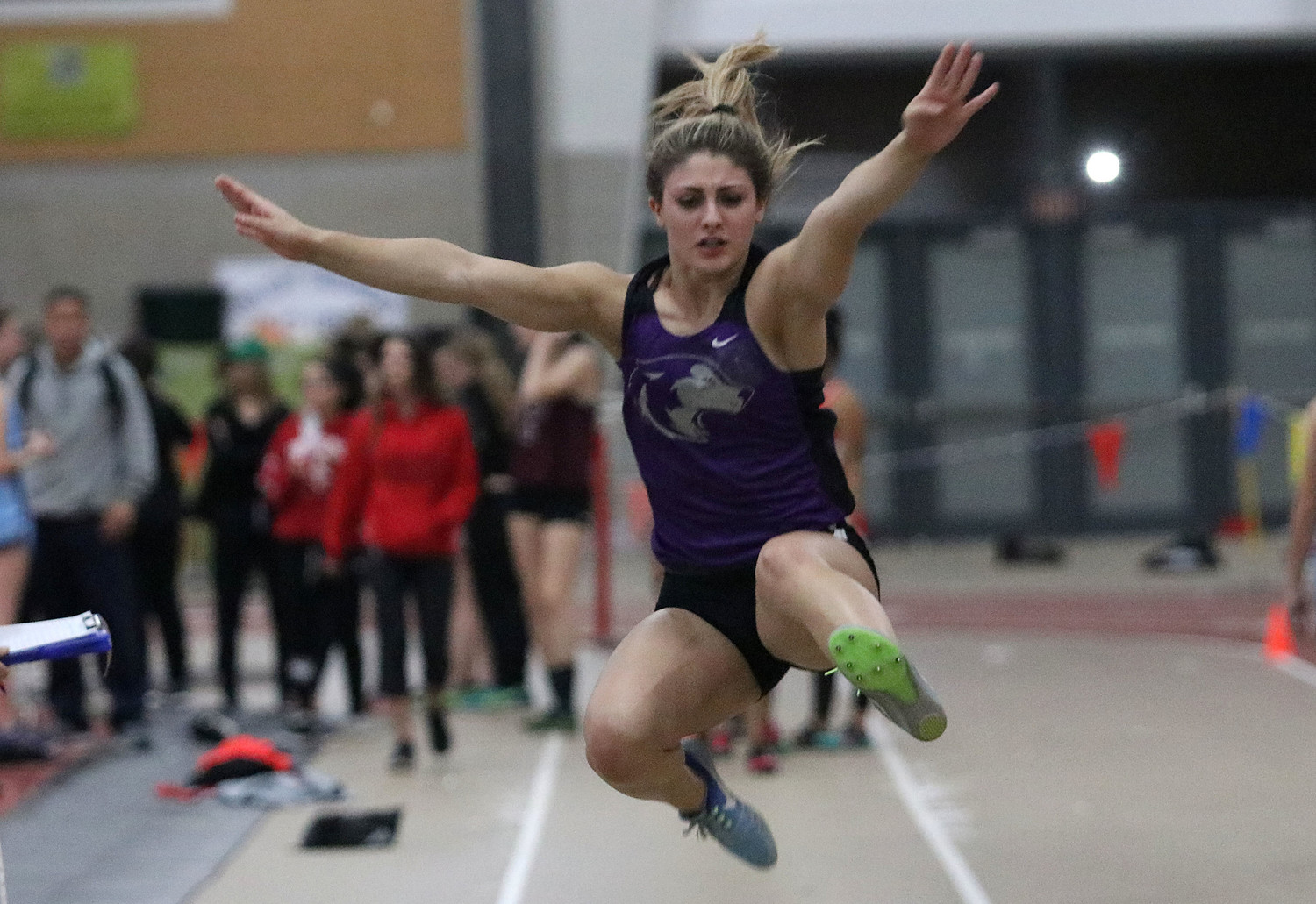 Junior Meghan Oliver leaps through the air during the long jump. She won the event with a jump of 16 feet 4 inches.