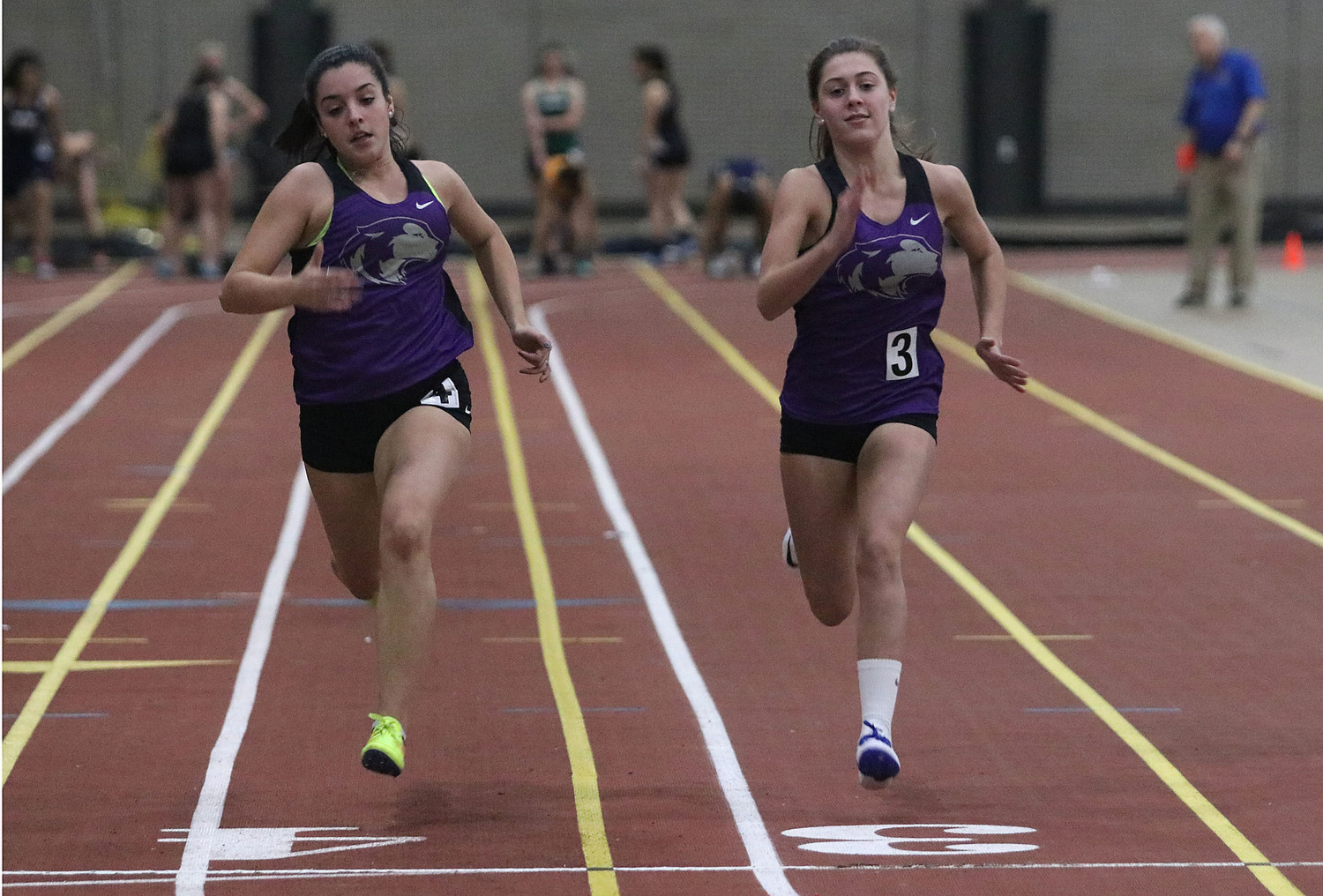 Kelsey Dias (left) and teammate, Kiley Bouchard race down the track during a 55 meter heat. Dias placed second and Bouchard placed third in the event.