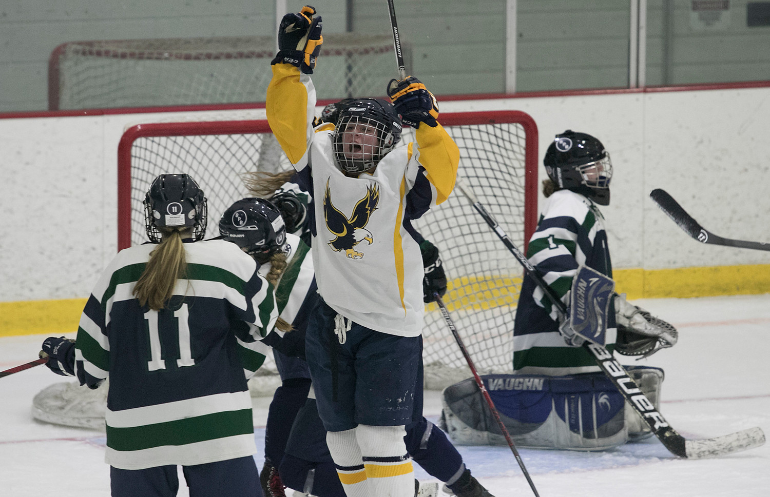 East Bay senior forward Mary Arkins celebrates after tying the game 2-2 in the third period.