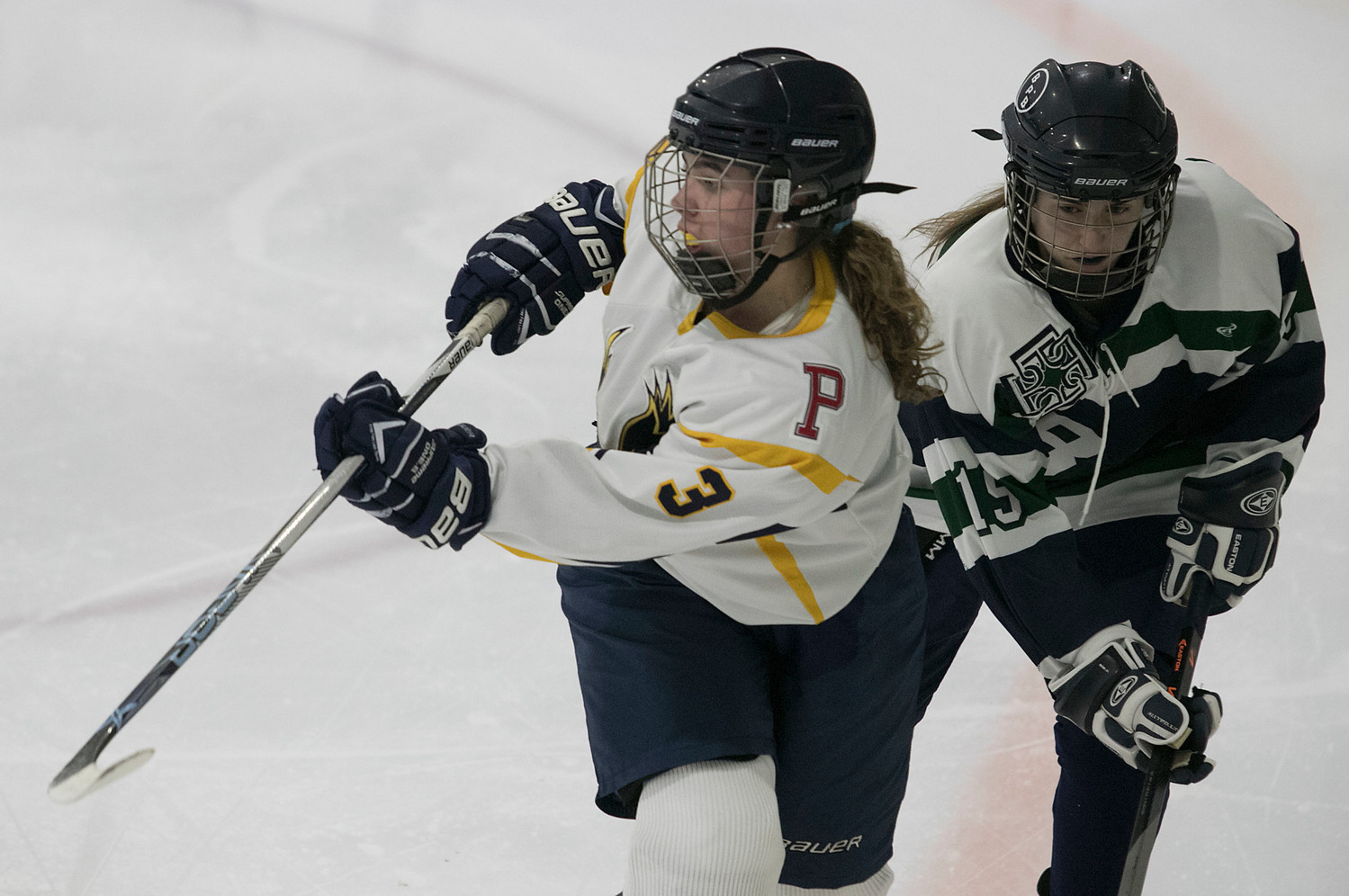 Forward Madison Cornell passes the puck up ice in the third period. She had an assist in the second period on a goal by Madelyn Cox.