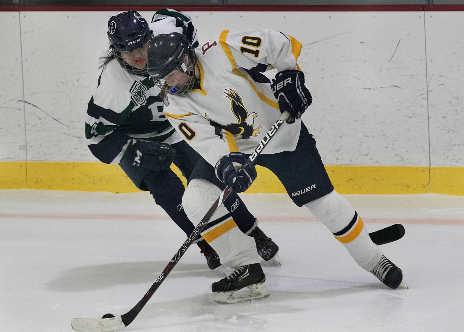 East Bay defenseman Madelyn Cox skates the puck into the offensive zone. She scored a goal and assisted on another during the game.