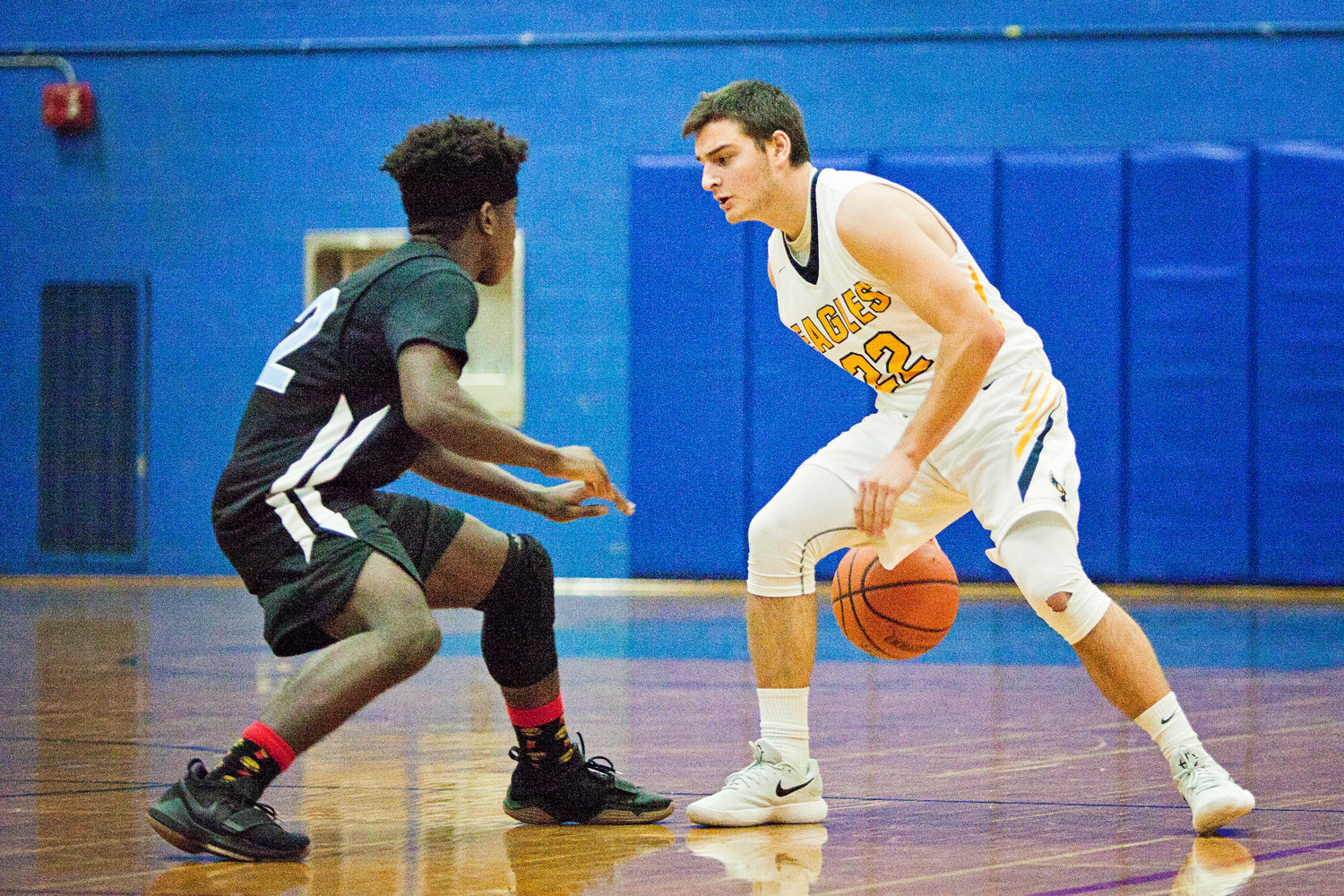 Barrington's Reid Nolan looks to drive past a Holy Name player.