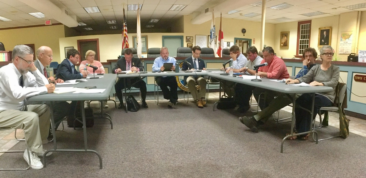 Members of the Warren and Bristol town councils discuss the Bristol Warren Regional School District's future at a meeting last year.