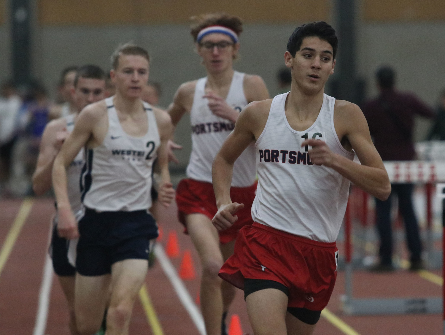 Vincent Gardner (right) keeps pace during the 1,500-meter run.
