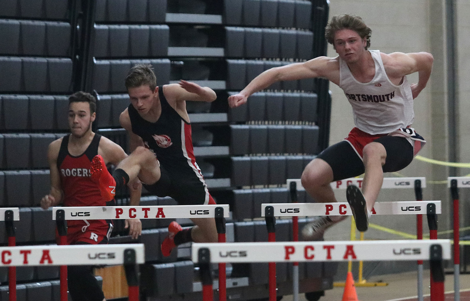 Martin Lasky leaps over a hurdle in the 55-meter hurdles.