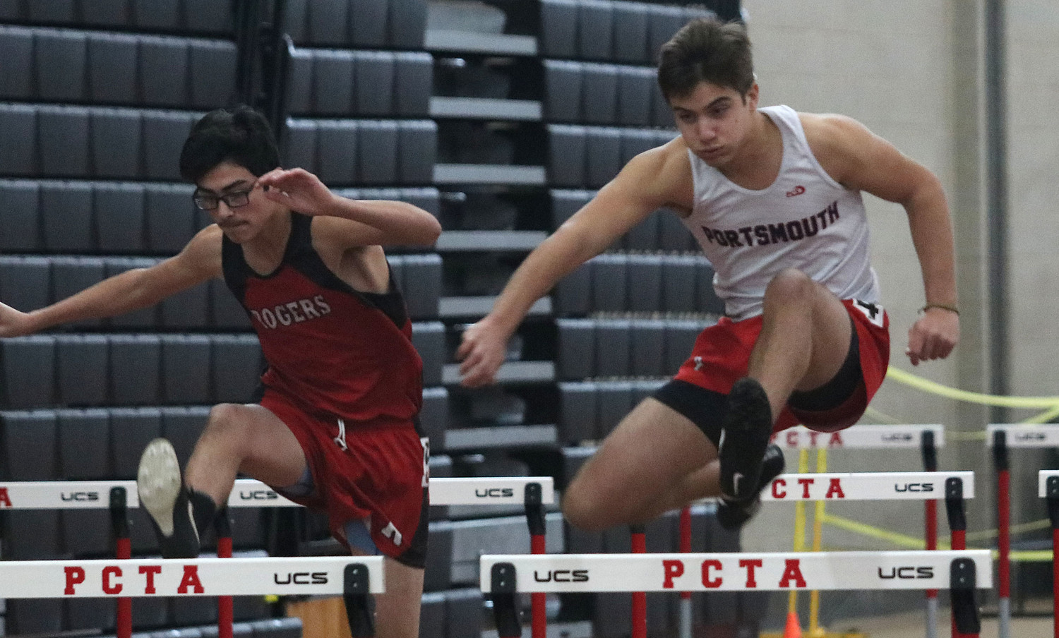 Dryden Eliason leaps over a hurdle during the 55-meter hurdles.