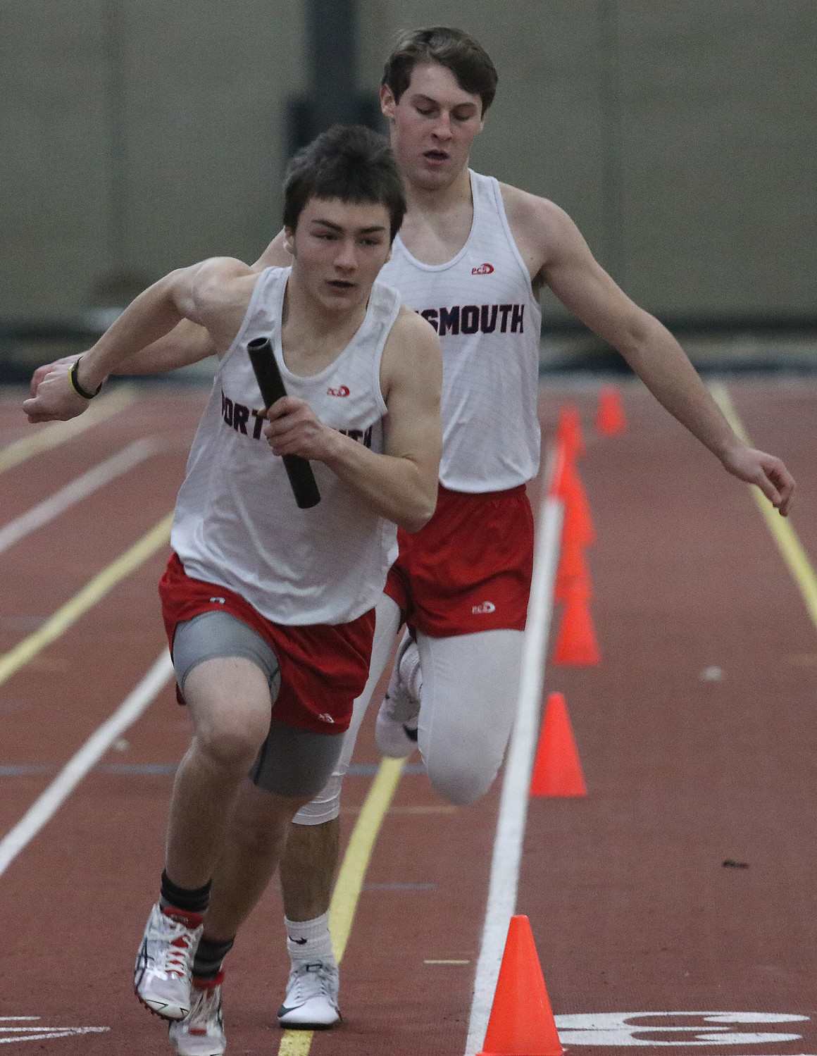 Brian Hamilton hands off to teammate Weller Littlefield during the 4x200-meter race.