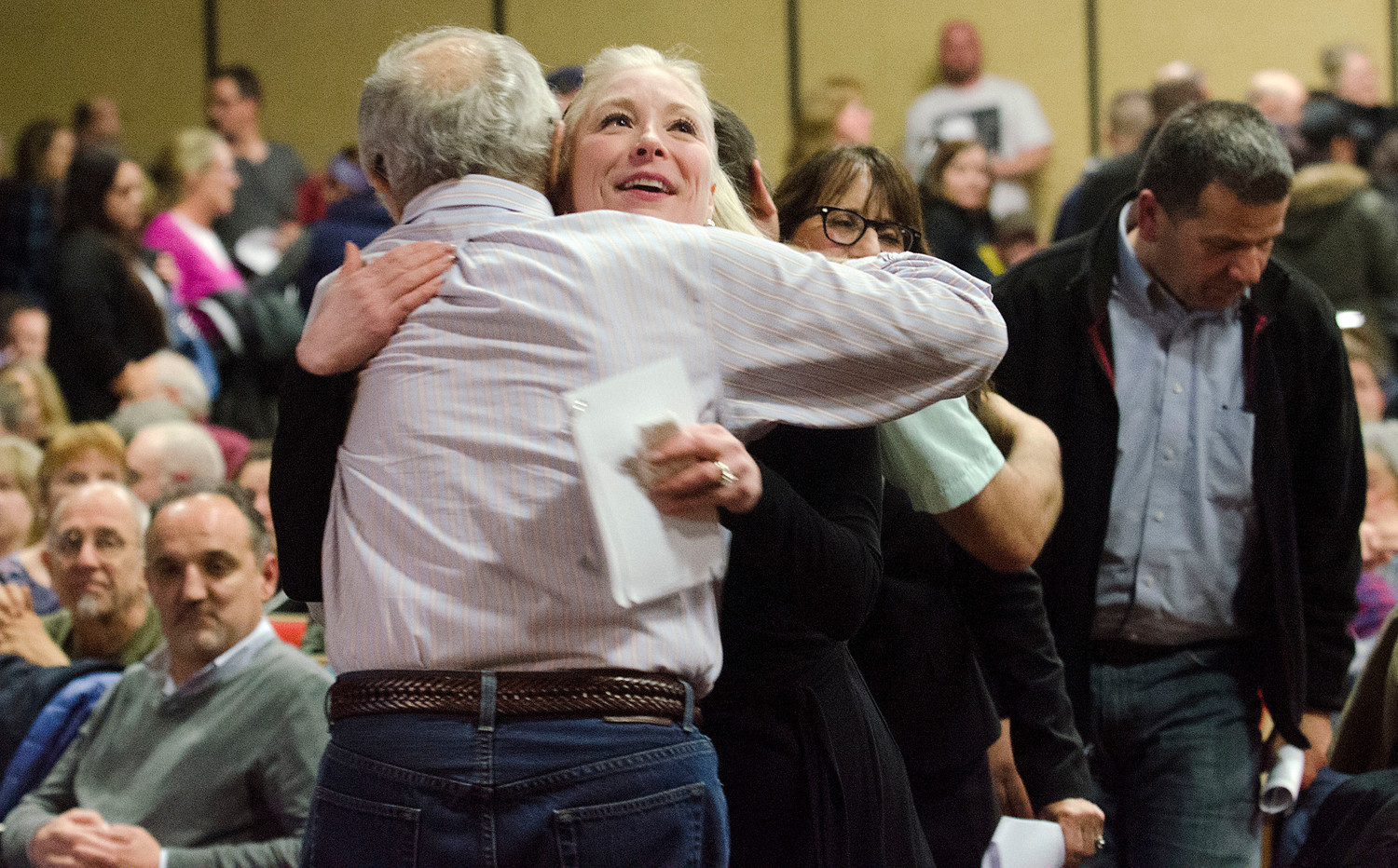Tracy Priestner a member of the school building committee, receives a congratulatory hug after the vote.