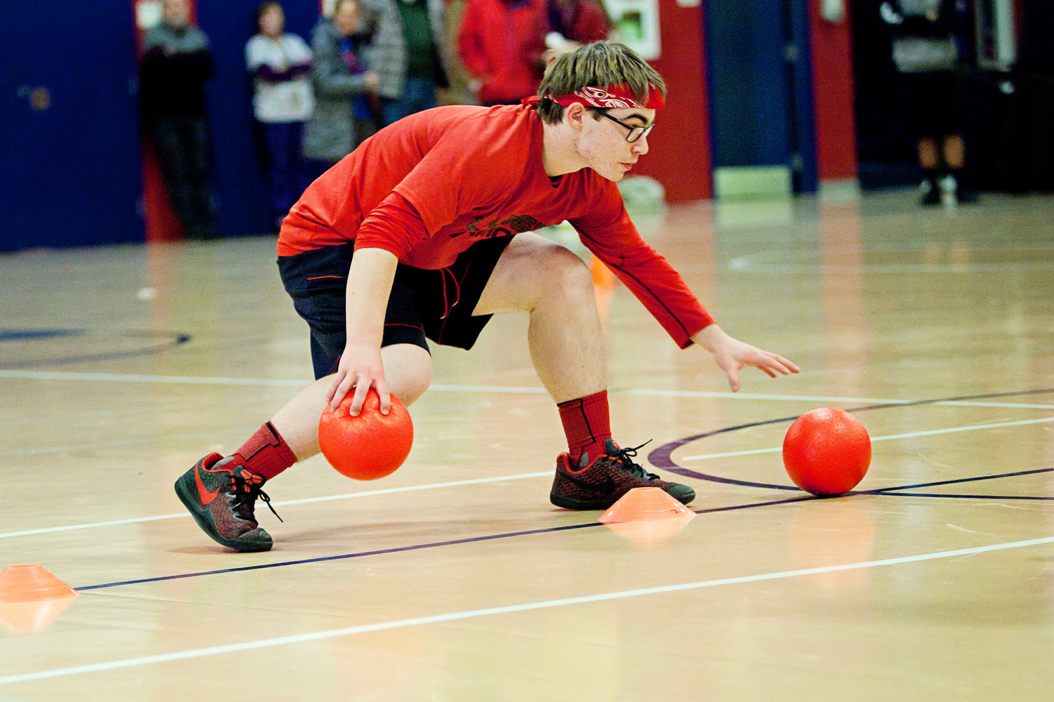 Sophomore Jacob Bloom, a member of the team Phillip Phlingers, gathers balls at the center line.