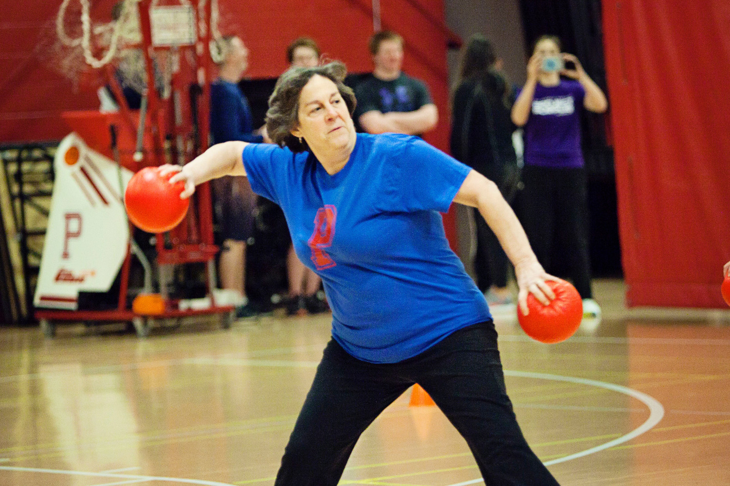 Emily Copeland, vice-chairwoman of the School Committee, hurls a ball while competing for The Hard Targets.