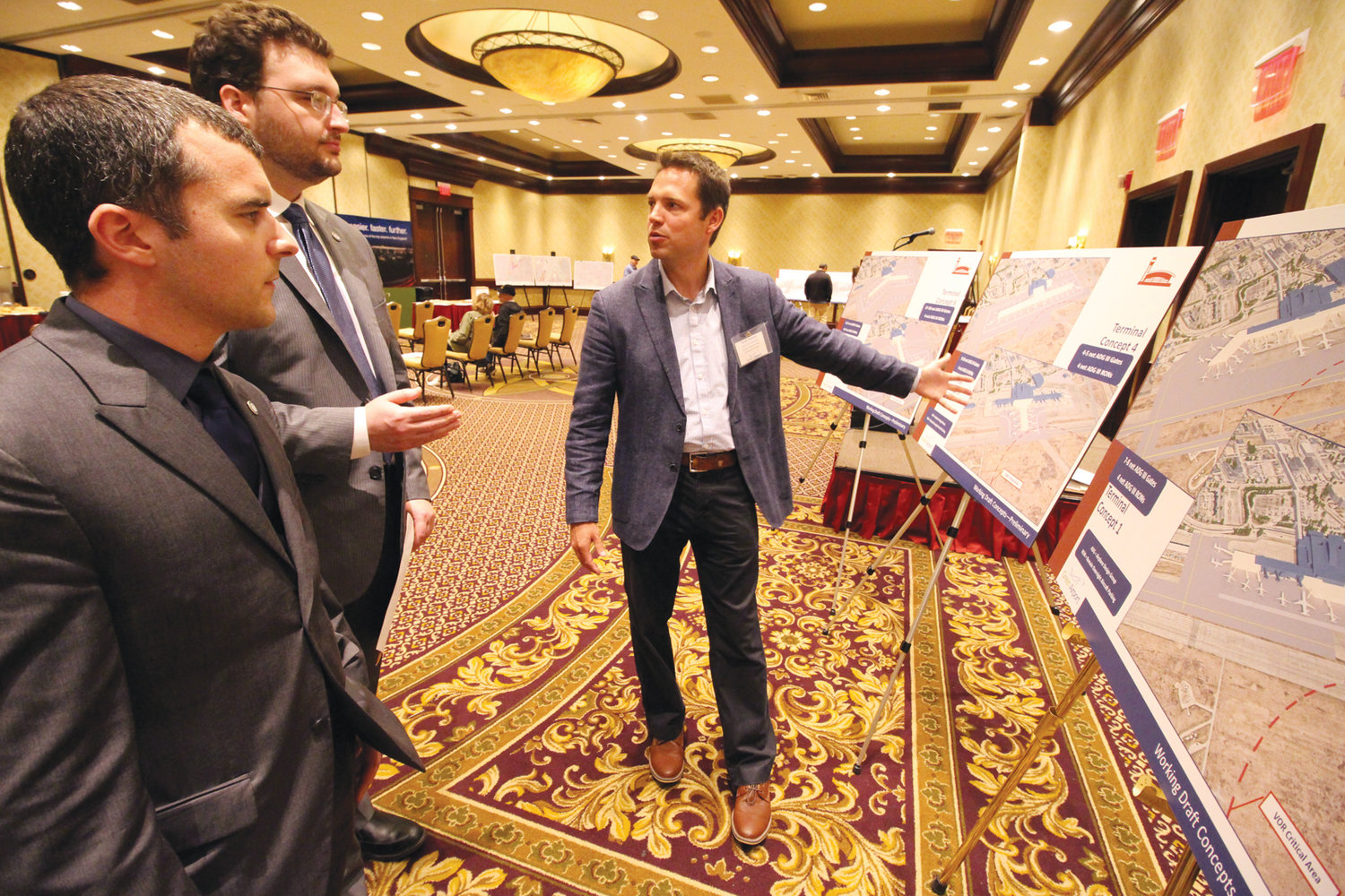 A BIGGER TERMINAL? Scott Tumolo of C&S reviews possible plans for the expansion of the Sundlun Terminal with Warwick City Council members Anthony Sinapi of Ward 8 and Jeremy Rix of Ward 2.