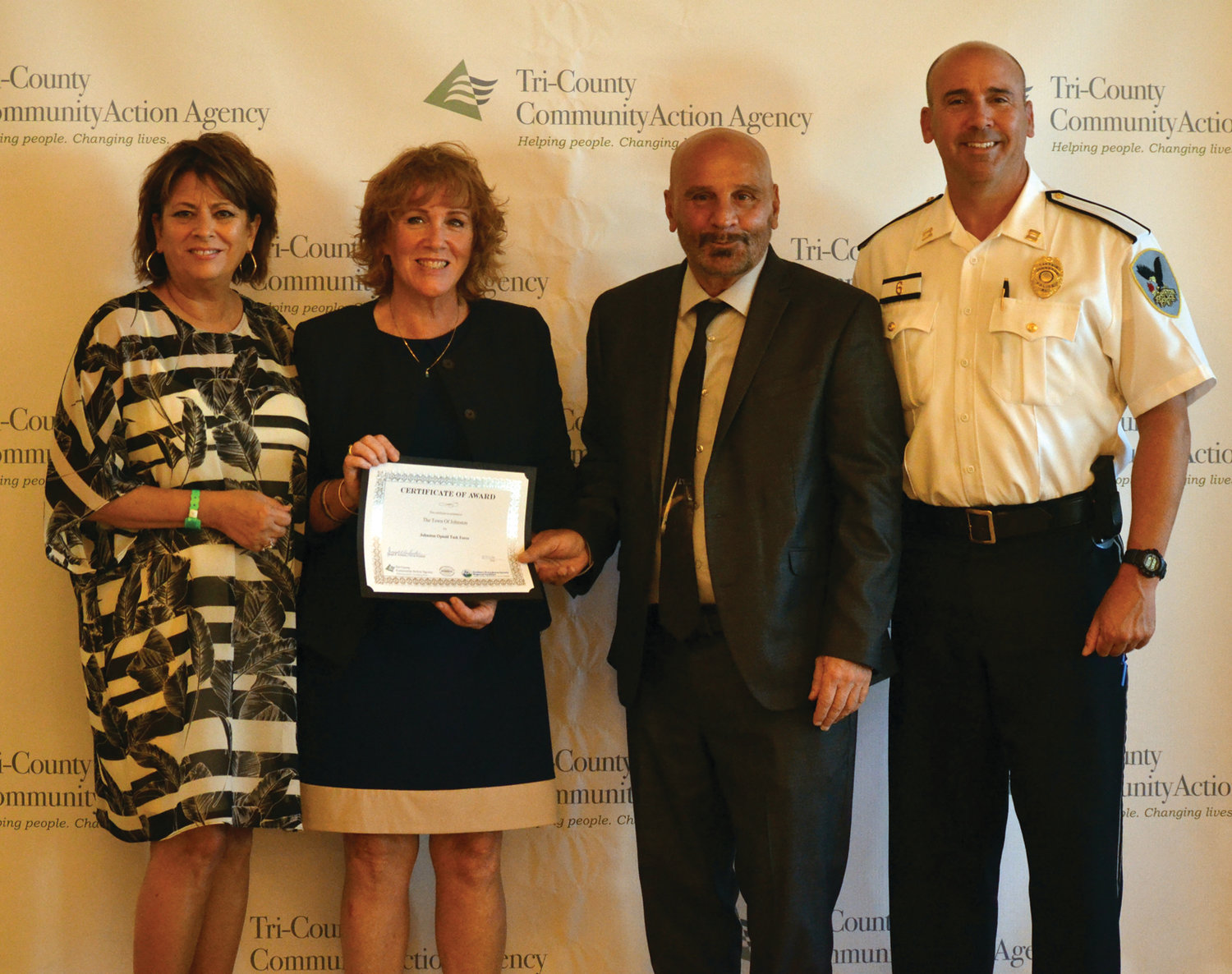 PROUD RECIPIENTS: Above, Tri-County COO Brenda Dowlatshahi (far left) and Johnston Police Capt. Christopher Correia (far right) accepted their grant from Department of Behaviorial Health, Developmental Disabilities and Hospitals Rebecca Boss (second left) and Tri-County President and CEO Joseph DeSantis.