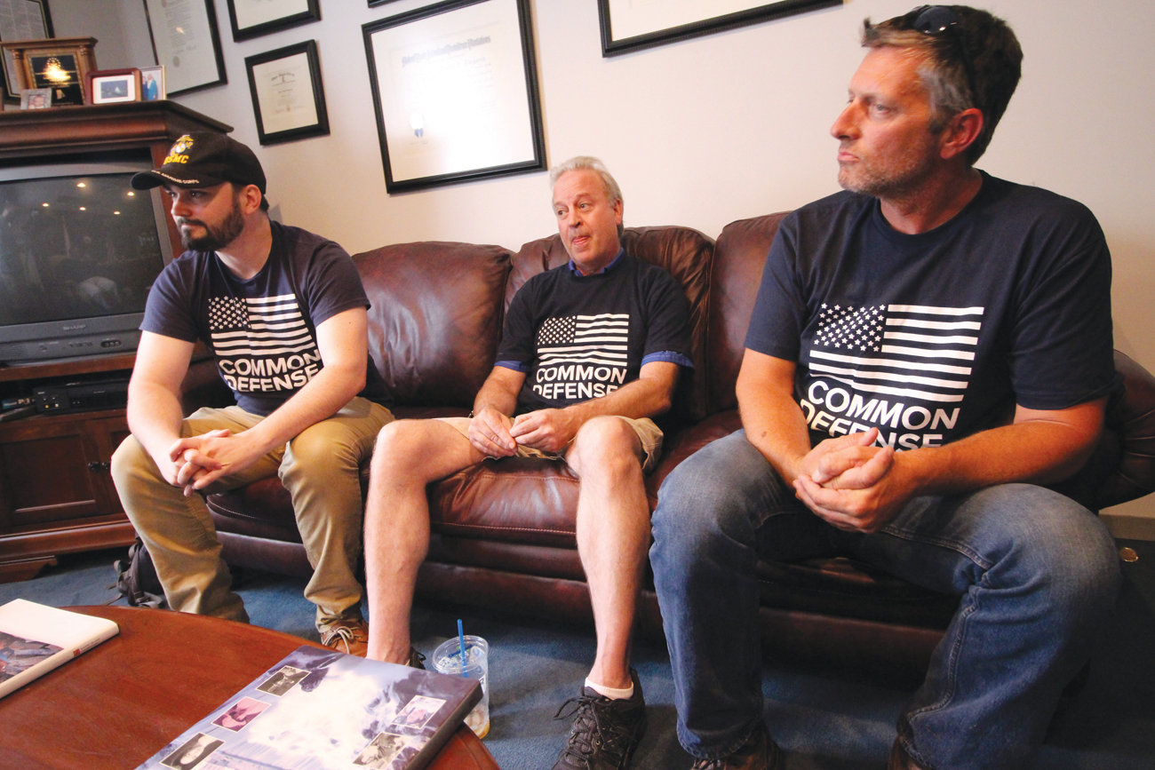 VETS AGAINST TRUMP: From left, Alexander McCoy, Patrick Reay and Jason Ayotte, three U.S. military service veterans, gather in U.S. Rep. Jim Langevin's Warwick office to applaud his support of impeaching President Donald Trump.