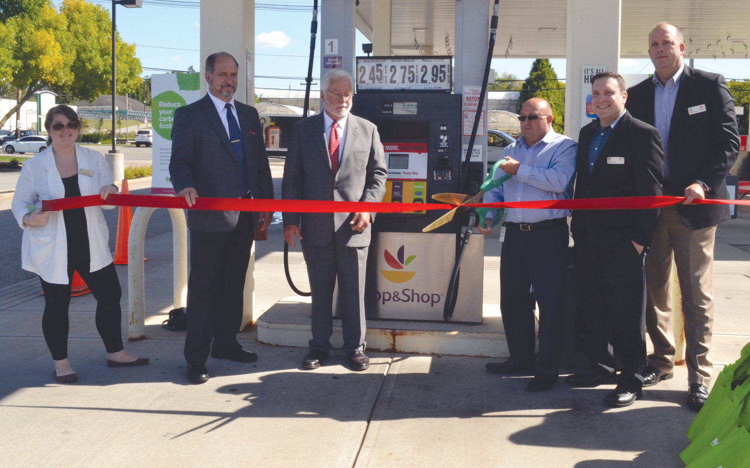 THE MARKET OF REDUCING CARBON: From left to right, GreenPrint strategic account manager Morgan Holmes, Johnston District 5 Town Councilman Robert Civetti, Northern Rhode Island Chamber of Commerce Vice President Paul Ouellette, Stop & Shop fuel specialist Ken Silvia, Johnston store manager Mike Clodi and district manager Scott Danis cut the ribbon Stop & Shop's Restore program during a ceremony Wednesday morning at the Stop & Shop at 11 Commerce Way in Johnston.