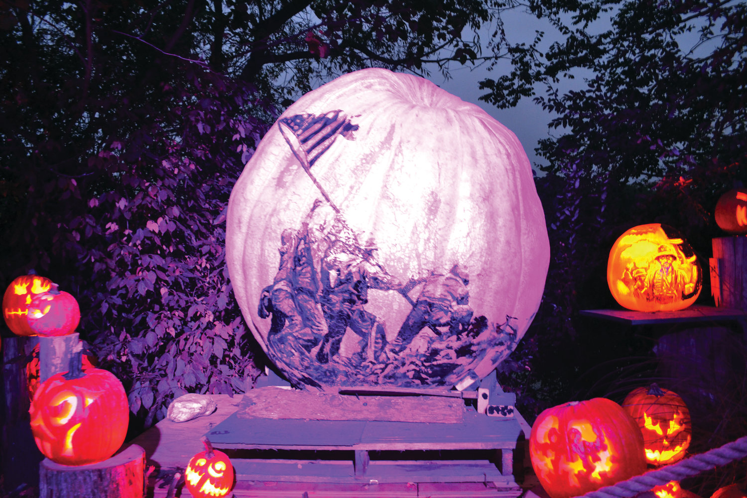 ONE OF THE BIGGEST: This 1,700-pound pumpkin depicting the flag planting at Iwo Jima is one of the heaviest featured at this year's Jack-O-Lantern Spectacular.