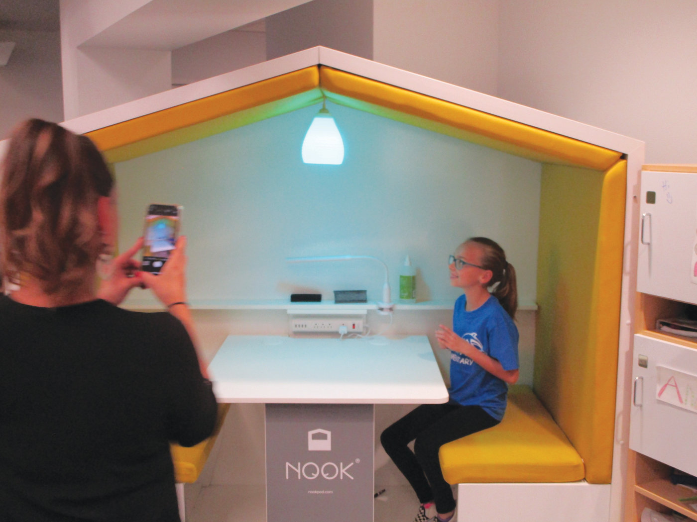 LEARNING NOOK: Fifth-grade student Ava Chiarello demonstrates the learning nook that is part of the new Learning Community wing at Eden Park Elementary School.