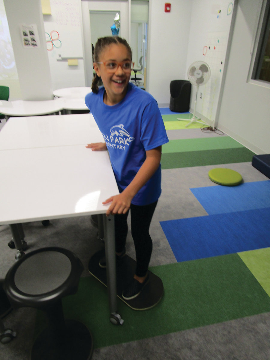 "ALL ABOARD: Fifth-grade student Mia McDaniel enjoys one of the balancing boards in the ""Mulligan's Island"" room in the Eden Park Learning Community."