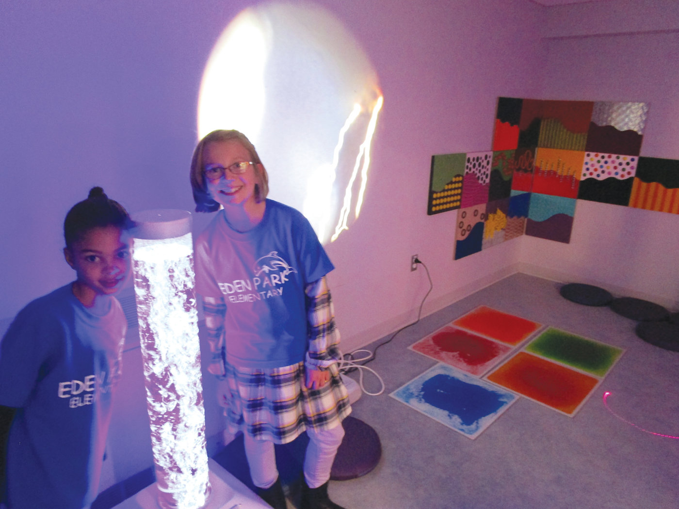A PLACE TO RECHARGE: Third-grader Sienna Fatorma and fifth-grader Mackenzie Stall had one of the best jobs during the open house – showing visitors the Sensory Room.