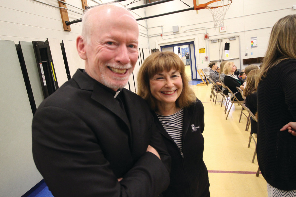 SHANLEY TEAM: Norwood teacher Patti Shanley and Father Brian Shanley, former president of Providence College and the twin brother of Patti's late husband, Paul, share a moment Monday during Coach Cooley's visit.