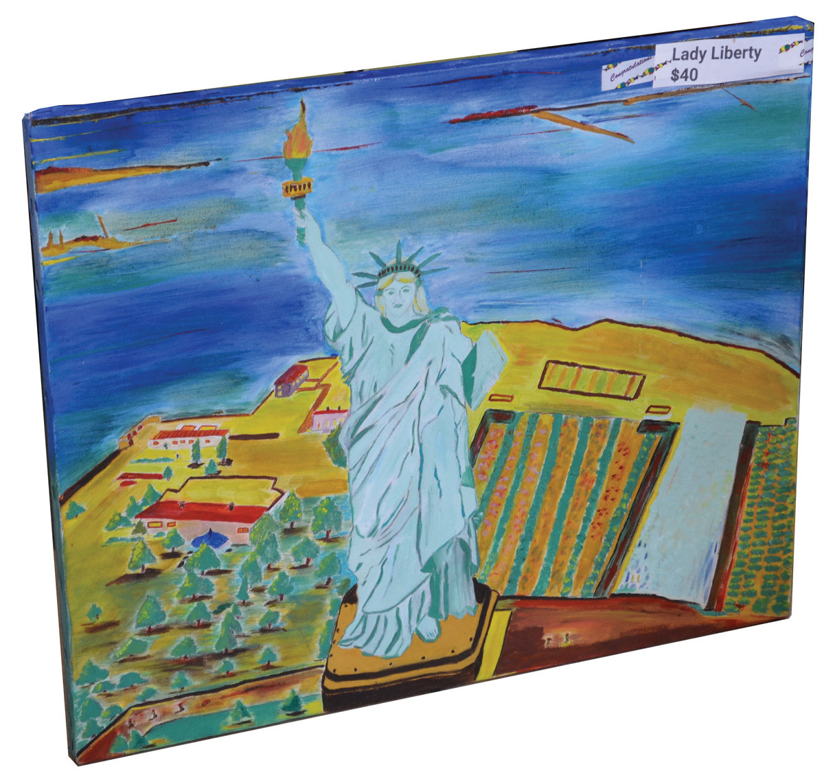 GLORIA'S GALLERY: Johnston's Gloria Renzi, 78, showed off some of her artwork at the Johnston Senior Center last Thursday, with paintings such as this one of the Statue of Liberty.