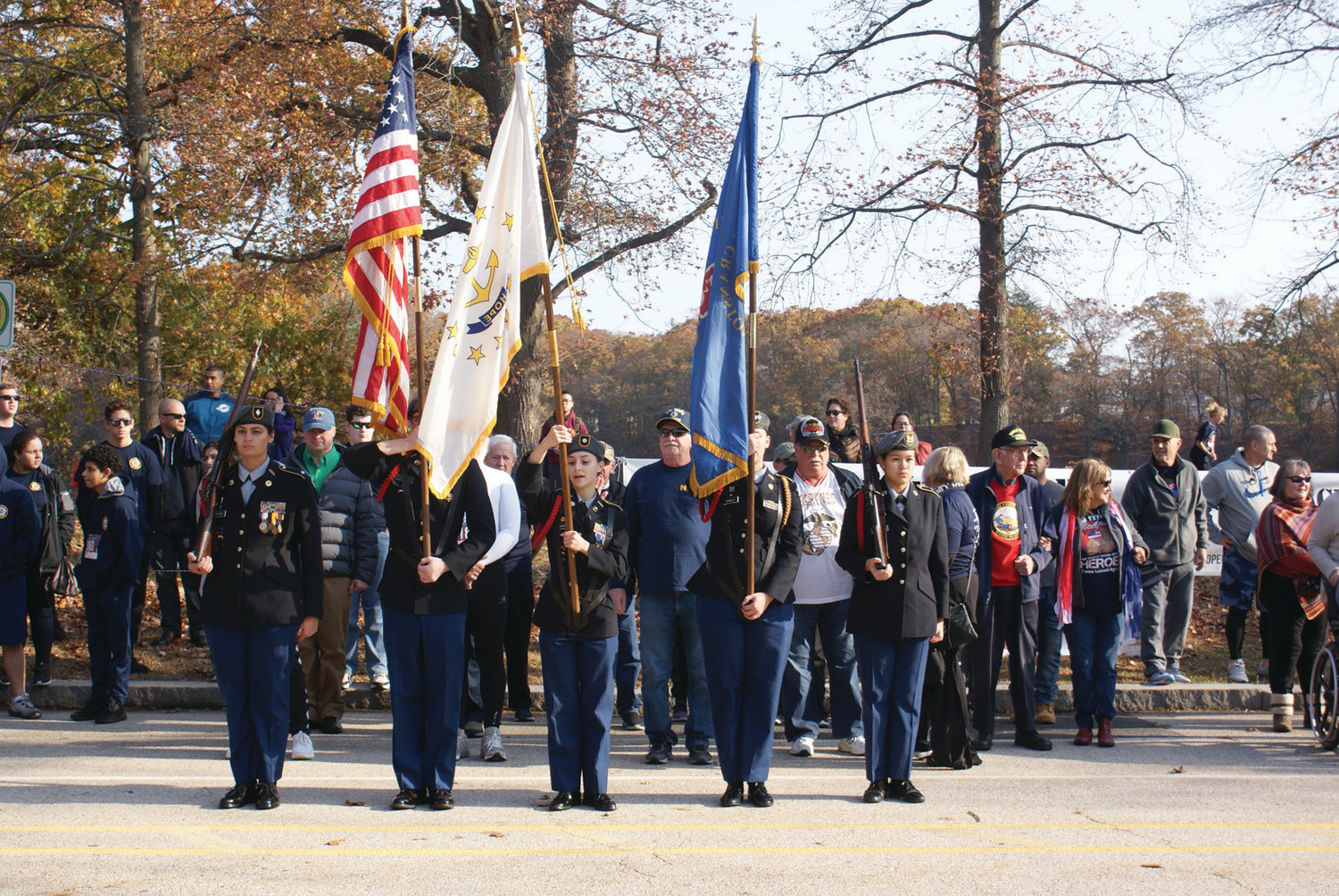 STEPPING OFF: The Cranston High School East JROTC led the way with veterans, dignitaries and special guests prior to the running of the seventh annual Park View Veterans Day 5K on Monday.