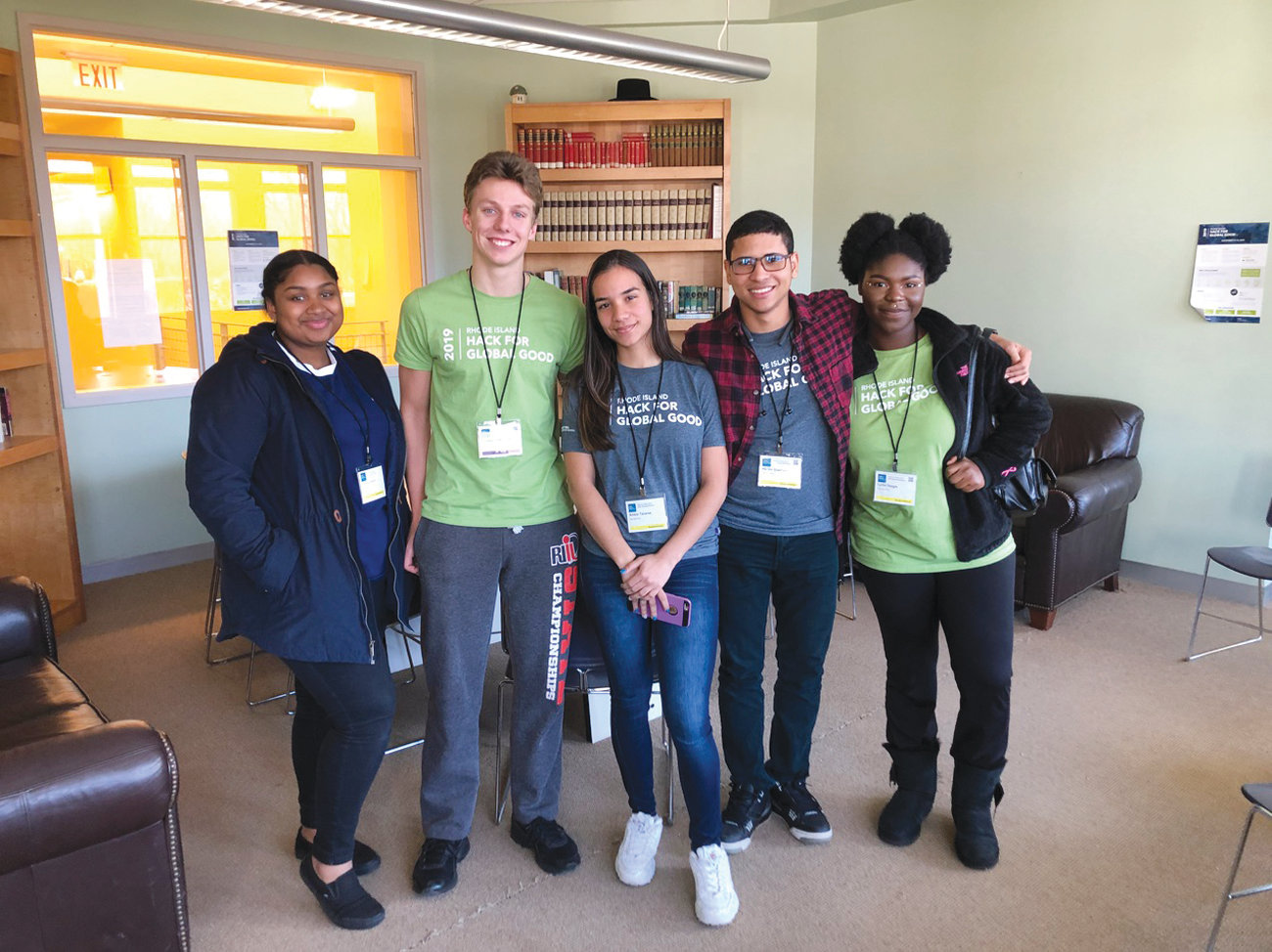 TEAMING UP TO SOLVE PROBLEMS: Hope High School junior Omayra Corporan (left) is joined by Rocky Hill senior Courtlandt Meyerson and Hope High School students Ambar Tavarez, Hector Guerrero and Lydia O. Watkins for a photo.