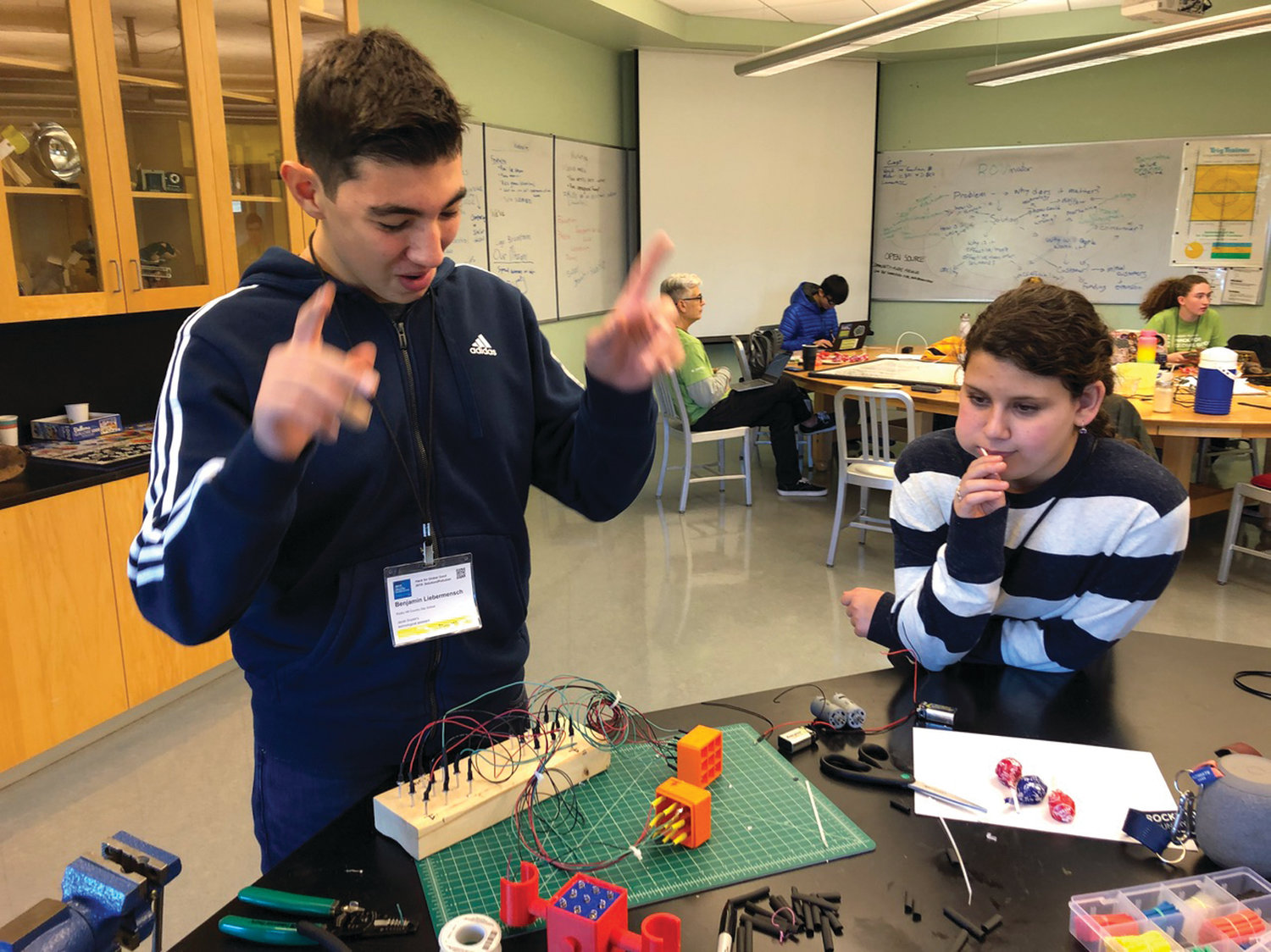 BOTS TO MINE DATA: Rocky Hill 10th grader Ben Liebermensch shows off his remote operated vehicle, or ROV, to seventh-grader Elizabeth Chernick. Liebermensch and Jacob Schneider have designed the mini-robots so they can collect data on ocean pollution.