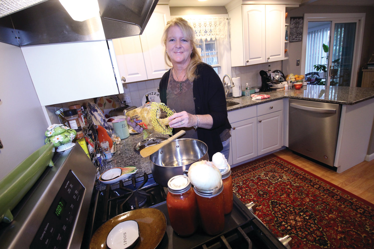 "Celebrating Tradition: Janice Torilli, the force behind reviving the ""Local Flavor"" cookbook enjoys cooking for her family, and is passing on her love of cooking to her grandchildren by cooking with them whenever they get the chance. (Beacon Communications photos)"