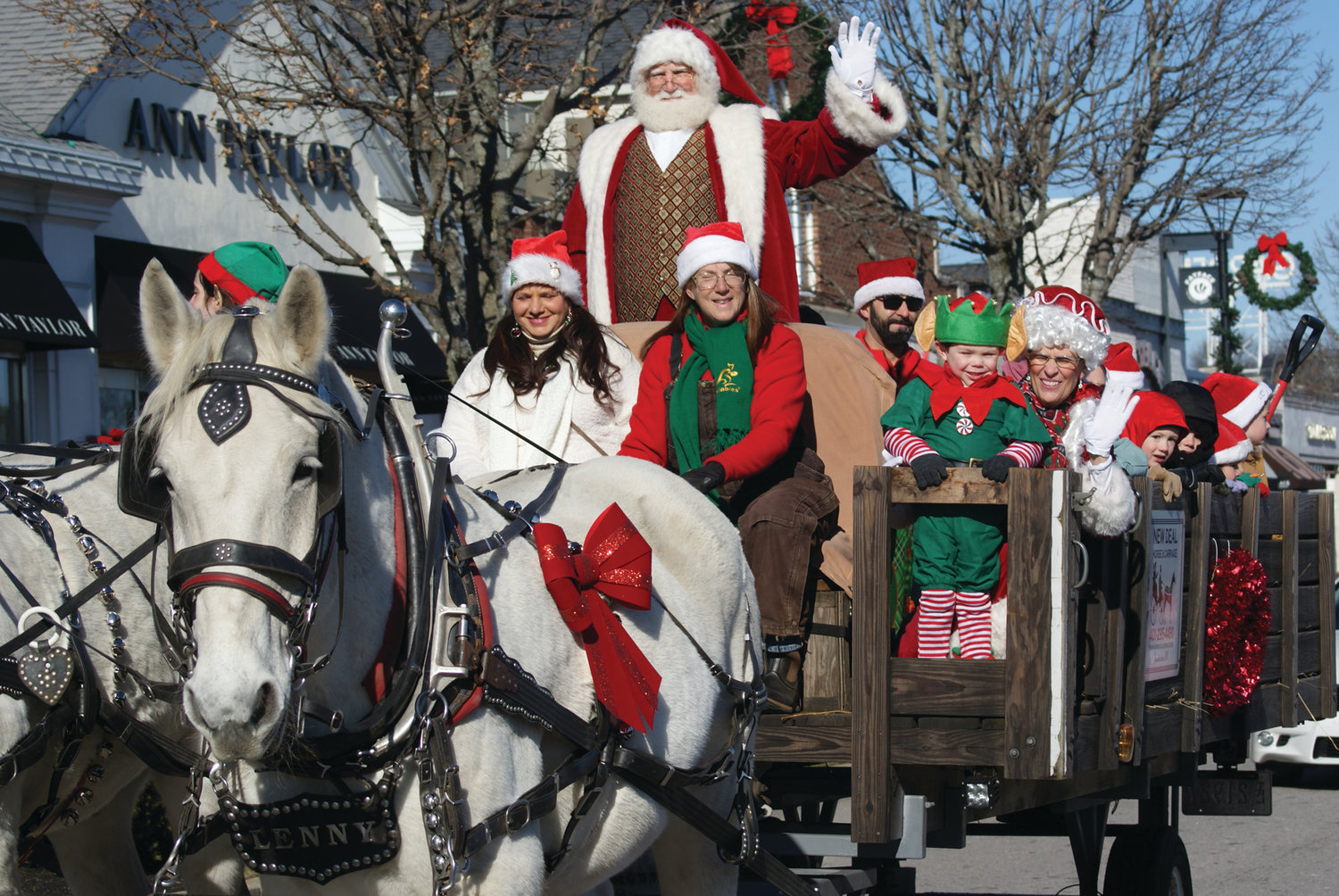 COUNTDOWN TO CHRISTMAS: Santa Claus and Mrs. Claus are greeted by hundreds of children of all ages in Garden City Center on Saturday. They arrived in a horse-drawn wagon pulled by horses Eddy and Lenny and driven by New Deal Horse & Carriage co-owner Julie Kliever and horse handler Melinda Michelotti.