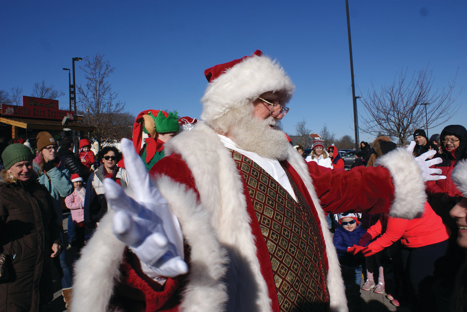 OPEN ARMS: Santa Claus greets visitors upon his in Garden City Center last Saturday.