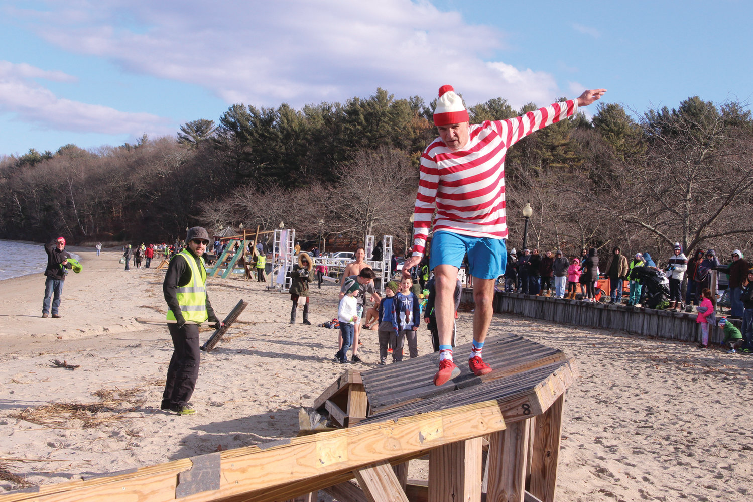 FINAL OBSTACLE: Larry Phillips, 58, from Red Hook, N.Y. runs the final challenge in the obstacle course before jumping into the bay. Phillips said he makes a point of participating in New Year's Day plunges and had this one on his list. He completed the obsta-plunge course in 16:52.