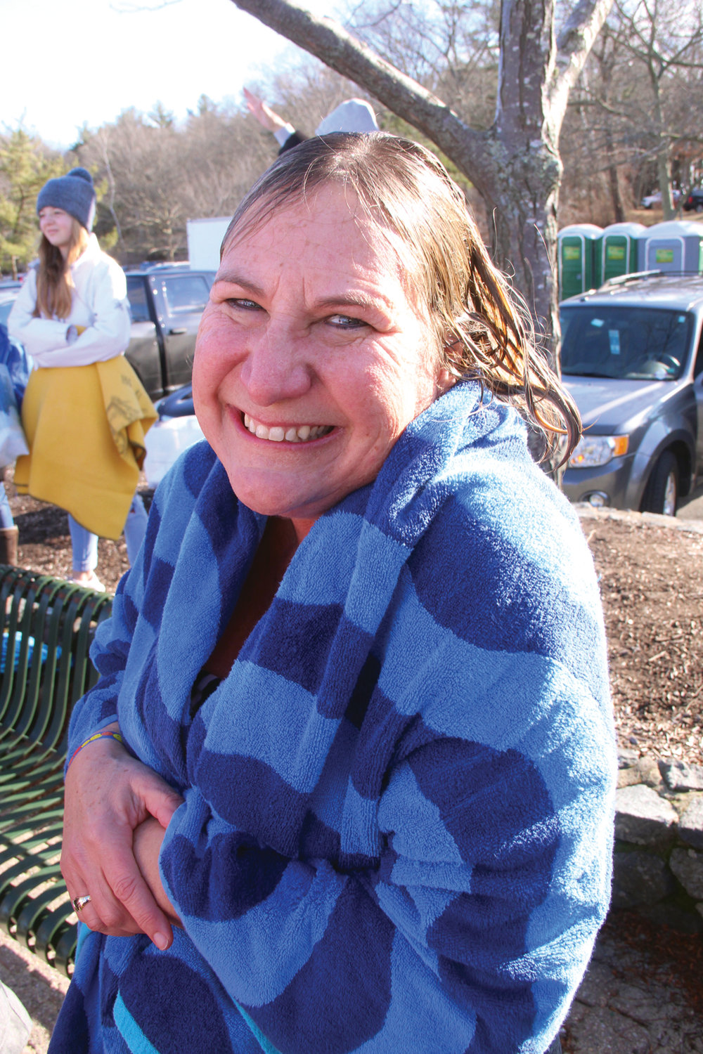 A COOL SMILE: A wet Julie Peterson quickly wrapped herself in a towel after taking the Frozen Clam Dip.