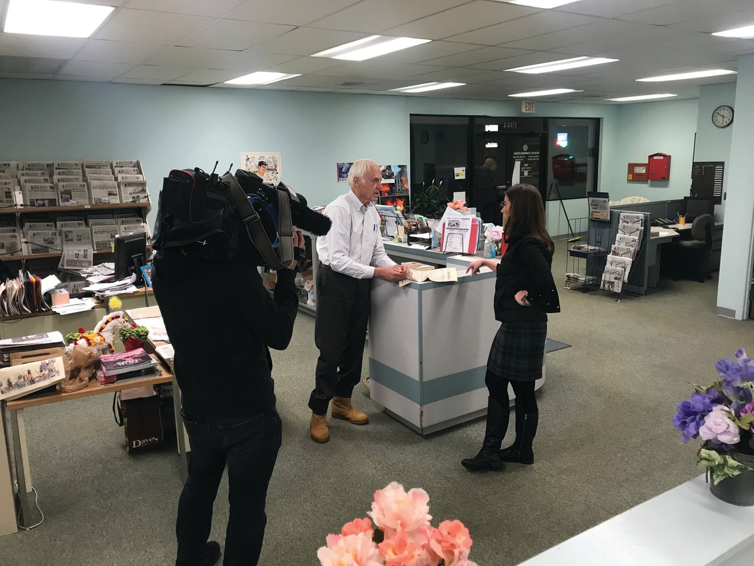 BEHIND THE SCENES: John Howell speaks with WPRI's Kim Kalunian during the taping of a recent segment on the 50th anniversary of his ownership of the Warwick Beacon.