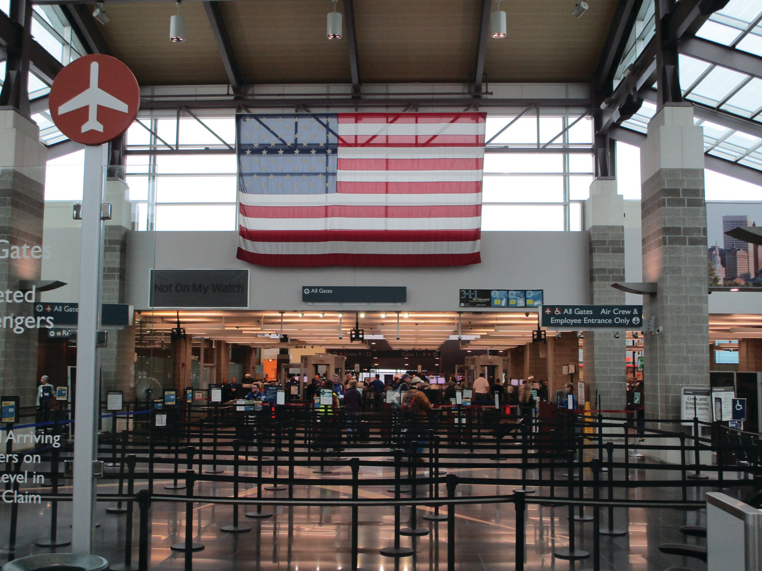 READY TO FLY: Volume was light and lines were short as travelers made their way through T.F. Green's security checkpoint on Friday. Approximately 4.3 million passengers flew from, or to, the airport in 2018.
