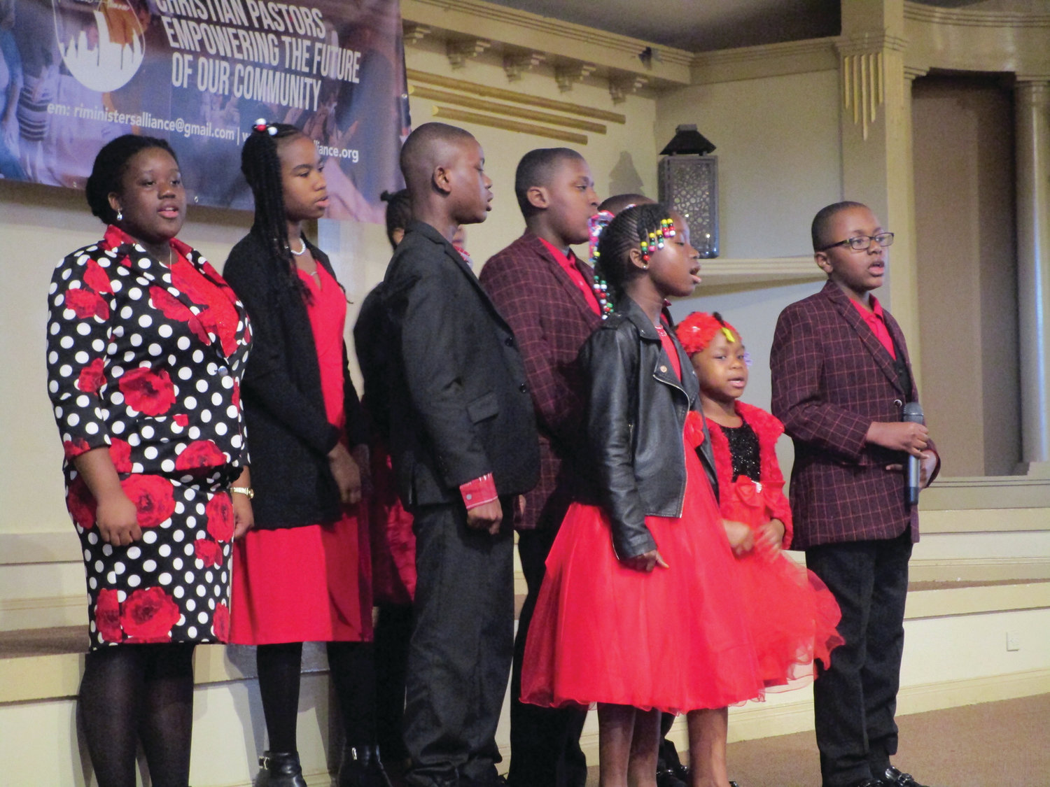 CELEBRATING WITH SONG: Members of Unity Chapel Children's Ministry provided musical entertainment before Carlon Howard's keynote address during Monday's MLK Day Scholarship Breakfast.
