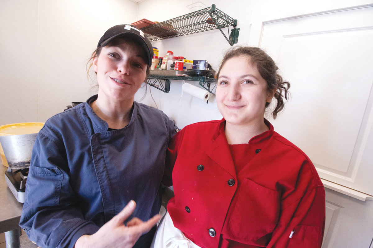 TIGHT QUARTERS: Chef Mel and student Kelsie Tridento worked the tiny club kitchen. (Herald photos)