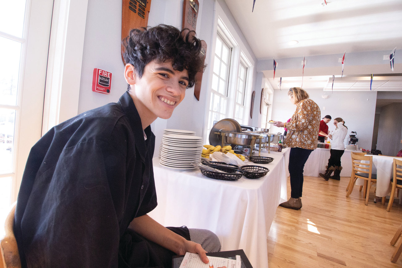 KEEPING TABS: Ben Silva kept a count of customers. About 60 attended the Sunday brunch.