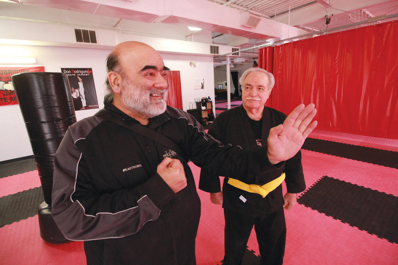 TEACHER AND STUDENT: Don Rodrigues (left) and Edgar Edwards inside the karate academy where Edwards, 85, earned his yellow belt.