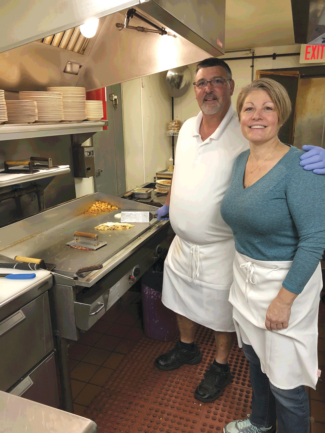 ORDER UP: Co-owners of PB&J's, Bill Landry and Patti Bacon, are ready to prepare a take-out breakfast for Carryout Wednesday.