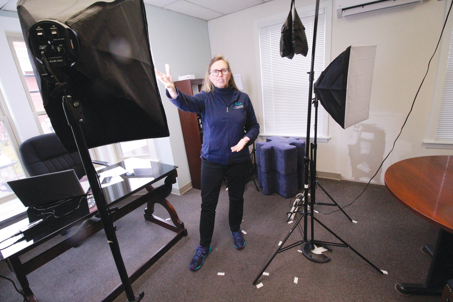 VIDEO CALL: Lauren Slocum, president and CEO of the Central Rhode Island Chamber of Commerce, records videos in an office studio to offer advice for businesses and employees as the virus takes its toll.