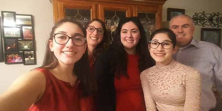 CLOSE-KNIT GROUP: Herald contributor and Cranston Public Schools communications specialist Jen Cowart gathers with her husband and daughters for a photo.