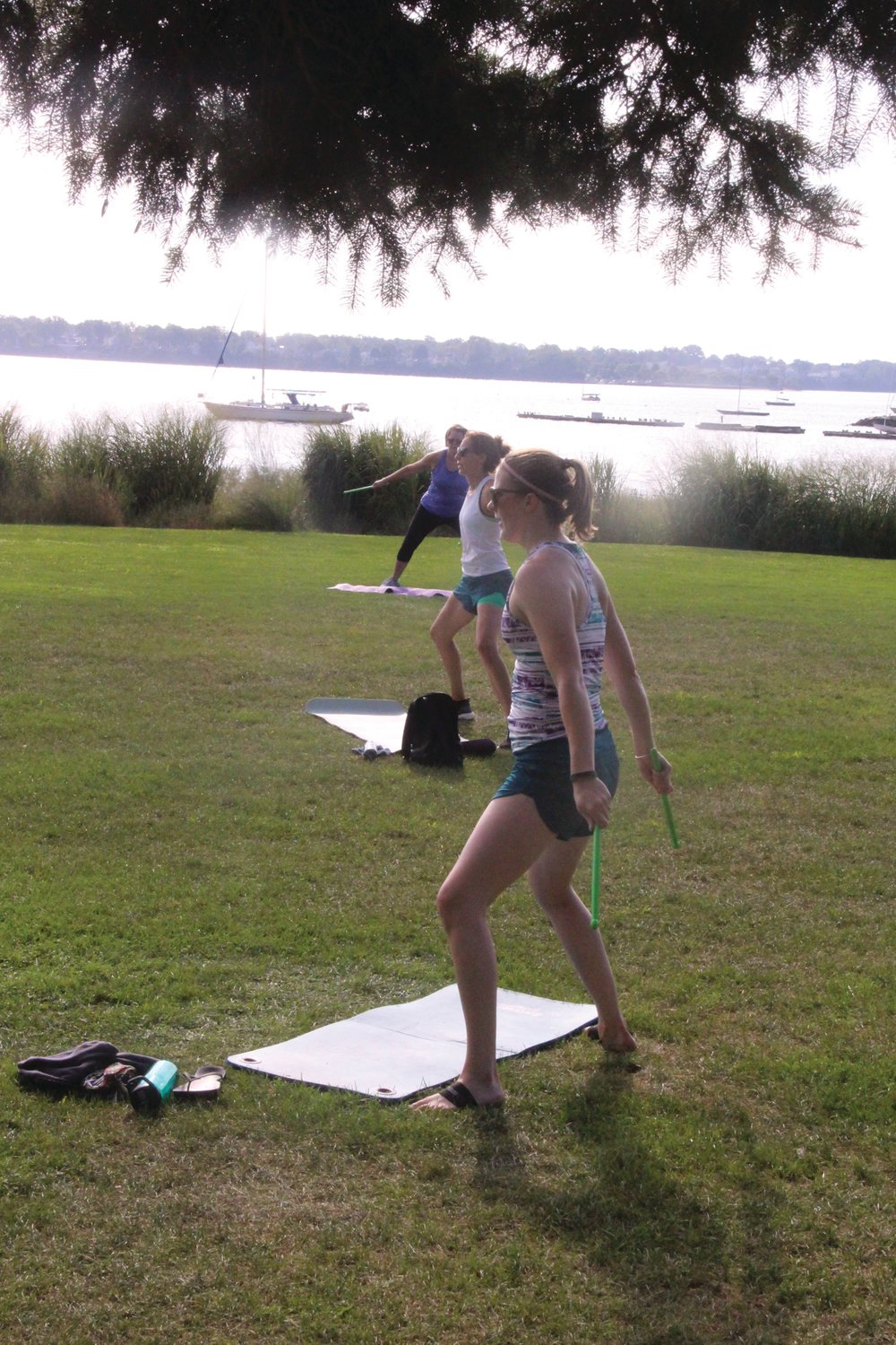 "SATURDAY MORNING WORKOUT: Carrie Pope discovered Edgewood Fitness for Women about a year ago and has been a devoted participant ever since. It doesn't hurt to have Stillhouse Cove as a backdrop to the ""pound"" routine, either."