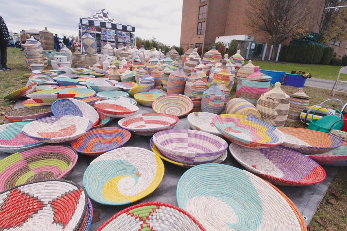 BASKETS BY THE BUNCH: BUTU International, which imports crafts from Africa, was one of the 87 vendors at Small Business Saturday at the Crowne Plaza.