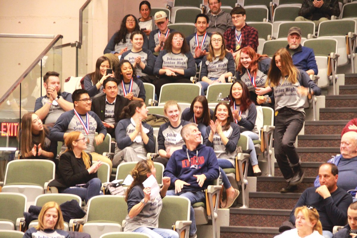 CHEERING TEAM: The 2020 Johnston Decathlon team fills a section of the CCRI Bobby Hackett Auditorium as members wait their turn to compete in the Super Quiz.